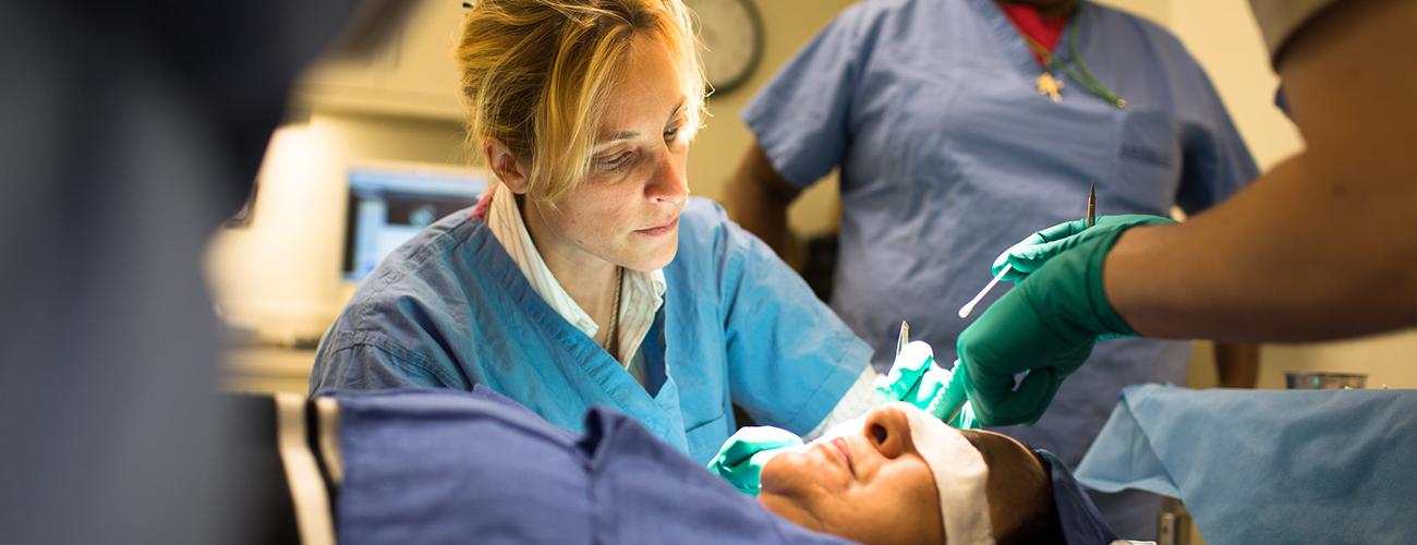 doctor tessa hadlock in operating room with trainees