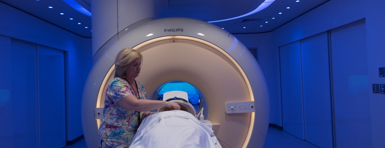 radiology technician sets up an MRI for a patient